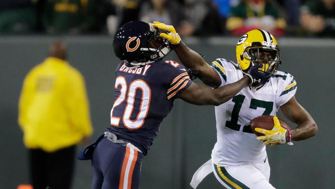Packers wide receiver Davante Adams (17) fends off Bears cornerback DeVante Bausby (20) on a second-quarter reception at Lambeau Field on Oct. 20, 2016.