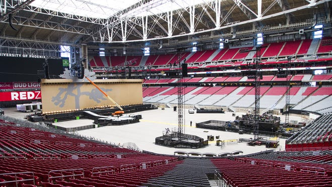Workers set up the stage, Monday, September 18, 2017, at the University of Phoenix Stadium, preparing for the U2 Joshua Tree Tour 2017 performance, Tuesday night, September 19.