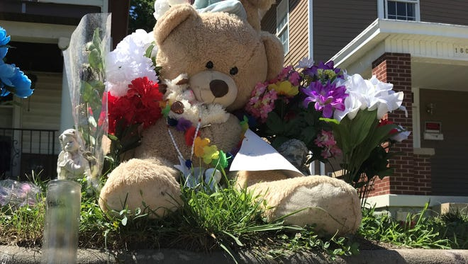 A memorial of teddy bears and flowers near the intersection of Woodlawn Avenue and Garfield Street in Middletown, where a 17-year-old teenager was fatally shot on May 29.
