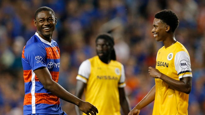 FC Cincinnati forward Fanendo Adi (9) smiles as he makes his team debut in the second half of the USL soccer match between the FC Cincinnati and the Nashville SC at Nippert Stadium in Cincinnati on Saturday, Aug. 4, 2018. FC Cincinnati gave up a late goal and settled for a 1-1 tie against Nashville.