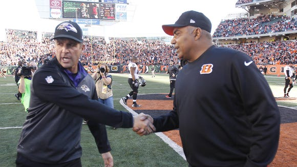 Bengals head coach Marvin Lewis (right) and  Ravens head coach John Harbaugh shake hands after the game.