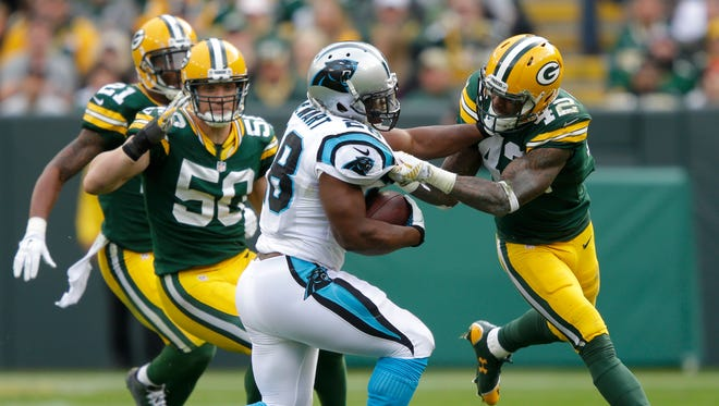 Packers safety Morgan Burnett brings down Panthers running back Jonathan Stewart on Oct. 19. Burnett's absence was felt in the run game against the Saints.