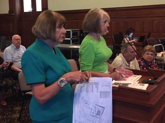 North Winton Village Association co-chairwomen Marilyn Schutte, left, and Mary Coffey talk to the city zoning board on Thursday.