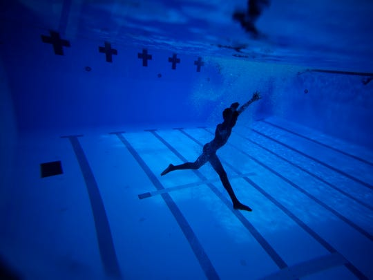 A diver swims underneath the surface during the Tomahawk Diving Team's practice at the Morcom Aquatic Center on Monday, May, 2, 2016. (1)