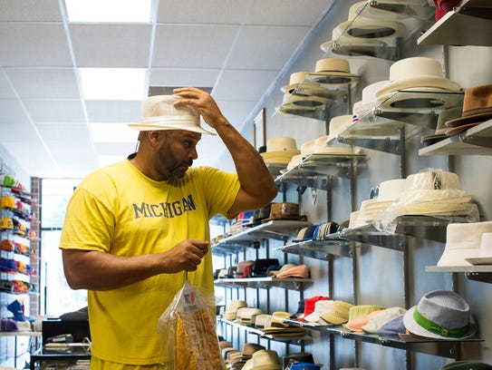 Alex Marshall of Lathrup Village tries on a hat on