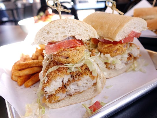 Fried shrimp and catfish po' boy with Old Bay fries