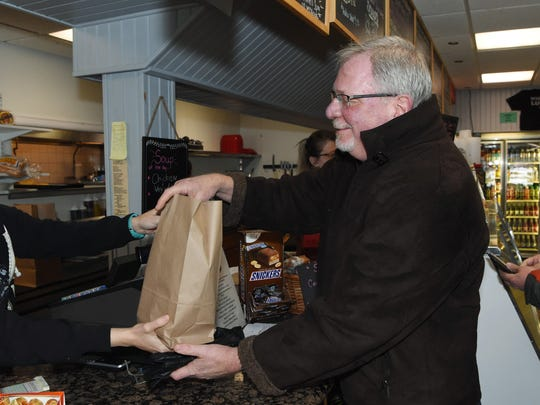 Robert Witowski of Gardiner receives his lunch in a paper bag at Russo's Italian Deli in New Paltz.
