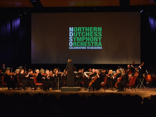 The Northern Dutchess Symphony Orchestra is shown performing on stage at the Culinary Institute of America's Marriott Pavilion.