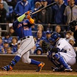 Home plate umpire Bill Welke is hit by a foul ball tipped by New York Mets' Yoenis Cespedes during the seventh inning of Game 1 of the Major League Baseball World Series Tuesday, Oct. 27, 2015, in Kansas City, Mo. Royals catcher is Kansas City Royals' Salvador Perez. (AP Photo/Matt Slocum)