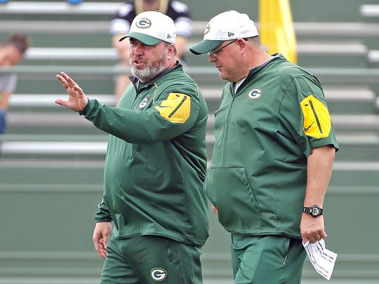 Green Bay Packers head coach Mike McCarthy, left, talks with offensive line coach James Campen during minicamp at Ray Nitschke Field June 15, 2016.