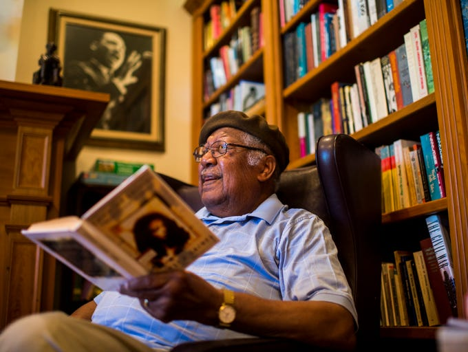 "Author Ernest Gaines reads a selection from his debut novel ""Catherine Carmier"" at his home library in Oscar, La., Tuesday, Sept. 23, 2014.  Paul Kieu, The Advertiser"
