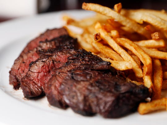The 8-ounce hanger steak with hand-cut french fries is cooked to order Wednesday, Dec. 6, 2017, at Django in Des Moines.