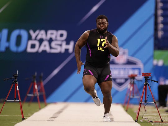 South Florida defensive lineman Deadrin Senat of Immokalee during a drill at the NFL Scouting Combine earlier this month. Senat did a workout during USF's Pro Day on Monday along with high school and college teammate D'Ernest Johnson.