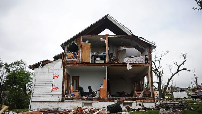 A house is severely damaged after a tornado tore through the area on June 19 in Wessington Springs, S.D. The extended winter caused a slow start to the U.S. tornado season.