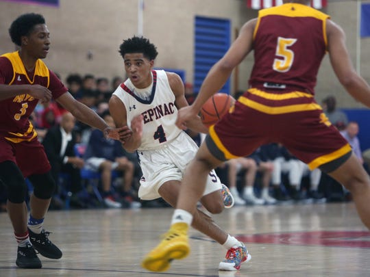 Stepinac's  R.J. Davis (4) drives to the basket against