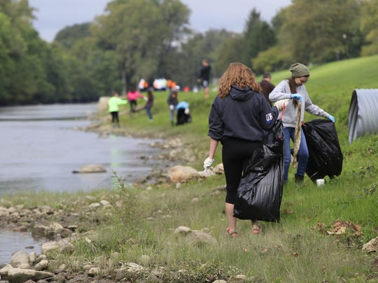 Hundreds of people came out for the White River Cleanup in this photo from September 2014.