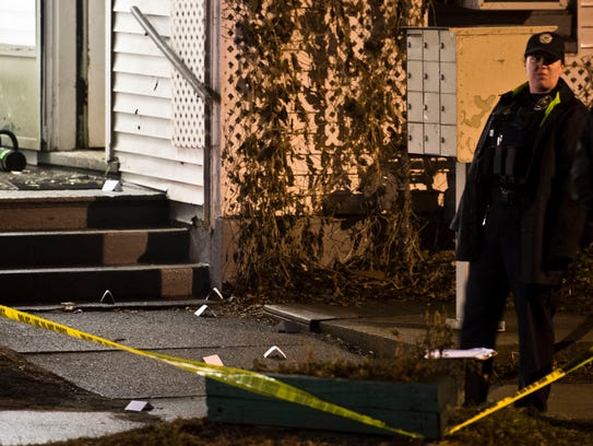 Police and DEA surround a home off Elmwood Avenue in