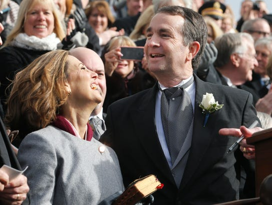 Gov. Ralph Northam, right, and his wife, Pam, smile