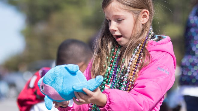Escambia Westgate's 25th annual Mardi Gras parade in Pensacola on Friday, February 3, 2018.