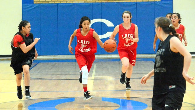 Loving's Liana Rodriguez leads a fast-break attempt in a summer league game against Roswell JV on Monday.