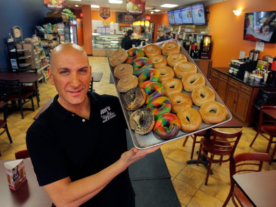 Owner Paul Cannavale displays a tray of bagels at Gem's Bagels in Middletown.
