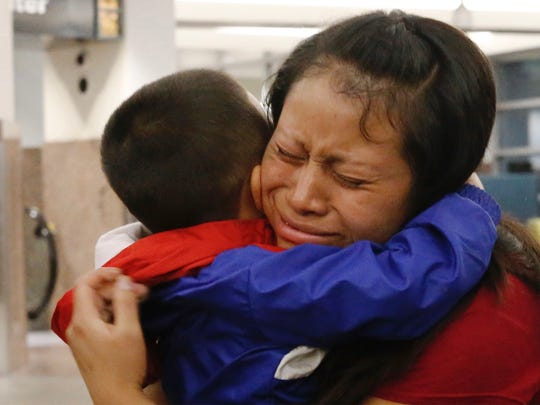 Maria holds her 4-year-old son, Franco, after he arrived at the El Paso International Airport Thursday night. The two had been separated for over six weeks after being caught entering the country illegally through Santa Teresa, New Mexico. Maria was held in an El Paso area detention facility while Franco was in New York City. The two are from Guatemala and plan to travel to Alabama to stay with relatives.