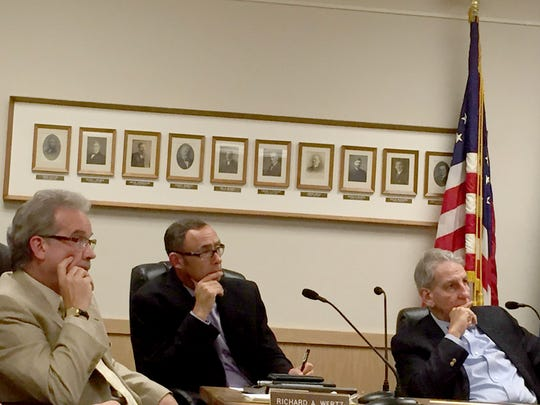 Lebanon City Council members (from left) Richard Wertz, Joe Morales and Wiley Parker listen Monday night as Jerry Kalinoski complains about the city's littering problem.