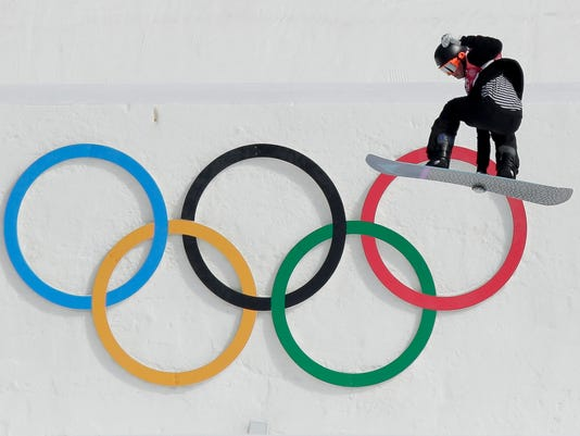 Knight Carlos Garcia, of New Zealand, jumps during the men's Big Air snowboard qualification competition at the 2018 Winter Olympics in Pyeongchang, South Korea, Wednesday, Feb. 21, 2018. (AP Photo/Dmitri Lovetsky)