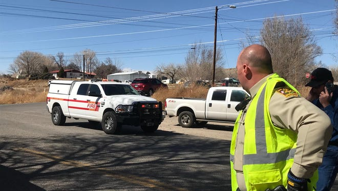 A San Juan County Emergency Management vehicle makes its way to the scene of a fire, Sunday, March, 4, 2018 in Flora Vista.