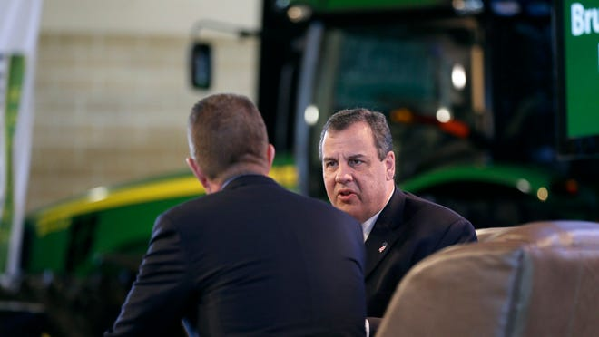 New Jersey Gov. Chris Christie is interviewed by host Bruce Rastetter, left, during the Iowa Agriculture Summit, Saturday, March 7, 2015, in Des Moines, Iowa. (AP Photo/Charlie Neibergall)