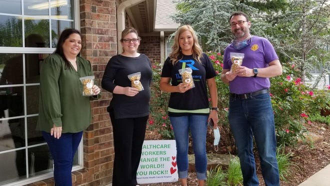 Kelli James (left) and Dr. Mitch Wolf (right) delivered snacks to the workers at The Regency on Bryan Street.