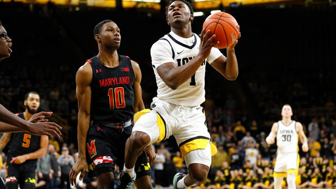 Iowa guard Joe Toussaint, center right, drives to the basket past Maryland guard Serrel Smith Jr., left, during the second half of an NCAA college basketball game, Friday, Jan. 10, 2020, in Iowa City, Iowa.