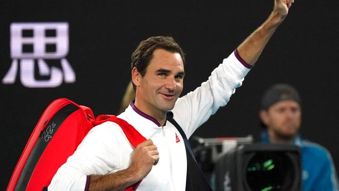 Switzerland's Roger Federer gestures to the crowd as he leaves Rod Laver Arena after defeating Hungary's Marton Fucsovics in their fourth round singles match at the Australian Open tennis championship in Melbourne, Australia, Sunday, Jan. 26, 2020.