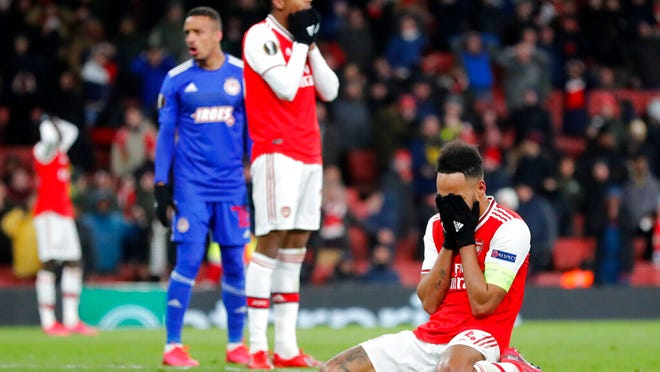 Arsenal's Pierre-Emerick Aubameyang reacts after losing the Europa League round of 32, second leg, soccer match between Arsenal and Olympiakos at Emirates stadium in London, England, Thursday, Feb. 27, 2020 .