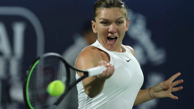 Romania's Simona Halep returns the ball to Tunisia's Ons Jabeur during a match of the Dubai Duty Free Tennis Championship in Dubai, United Arab Emirates, Wednesday, Feb. 19, 2020.