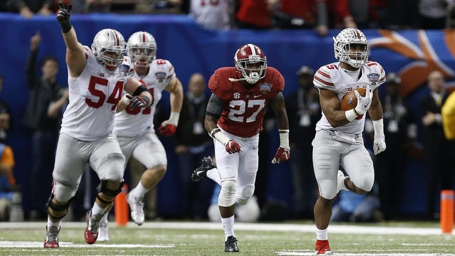 Running back Ezekiel Elliott breaks away for an 85-yard touchdown run in the fourth quarter against Alabama in a semifinal of the inaugural College Football Playoff on Jan. 1, 2015, in New Orleans.