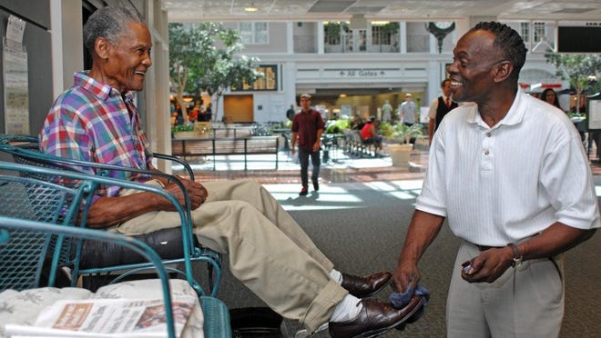 A file photo Willie Banks, owner of Mr. Willie's Shoeshine Service at the Savannah-Hilton Head International Airport.