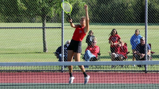 Mila Jenniges returns a shot during her third doubles match Sept. 3 at the RVHS tennis courts. She would team up with Brooke Zollner for a win.
