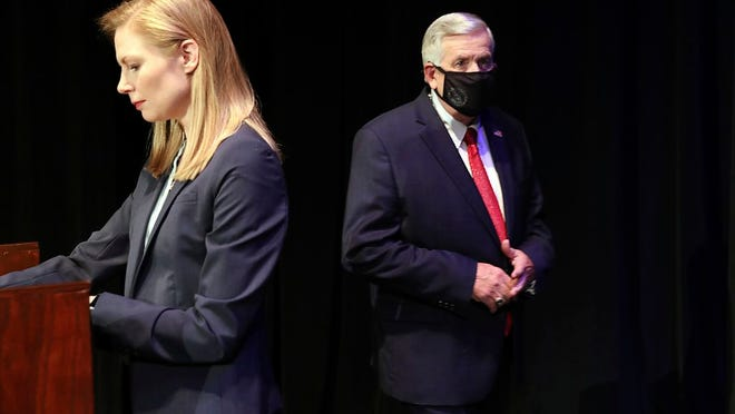 In this Oct. 9, 2020, file photo, Missouri gubernatorial candidates, Gov. Mike Parson, and State Auditor Nicole Galloway are seen onstage before the Missouri gubernatorial debate at the Missouri Theatre in Columbia, Missouri. They are opposing each other in the Nov. 3, 2020, general election.
