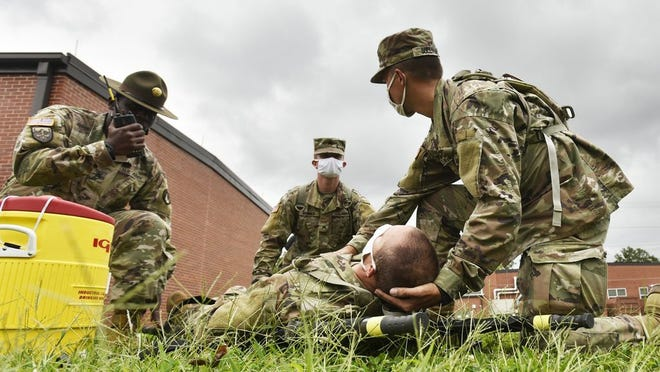 Staff Sgt. Maurice Lacy, a drill sergeant assigned to Company A, 3rd Battalion, 10th Infantry Regiment, runs a Man-Down Drill Sept. 2 with Sgts. Beau Brunner and Peter Sullivan, and Spc. John Navarra as the simulated casualty. The battalion trains on the drill daily to provide confident and effective execution of potentially life-saving measures when needed.