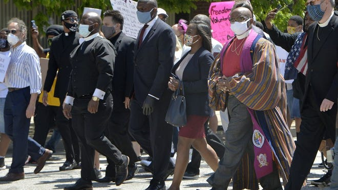 Community leaders and clergy members march in Erie, Pennsylvania. The protest march was staged following the death of George Floyd at the hands of Minneapolis police.