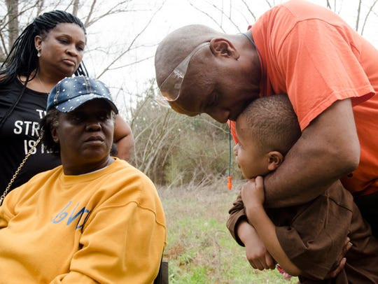 Marvin Arms, right, comforts his grandson, Kash Bartee, 4, after Bartee survived a house fire on the 3000 block of Savage Drive in Montgomery, Ala., on Friday, Feb. 16, 2018 as his grandmother, Blanche Johnson, who pulled him out of building looks on. Bartee's brother, Landon Johnson, 2, died in the fire.