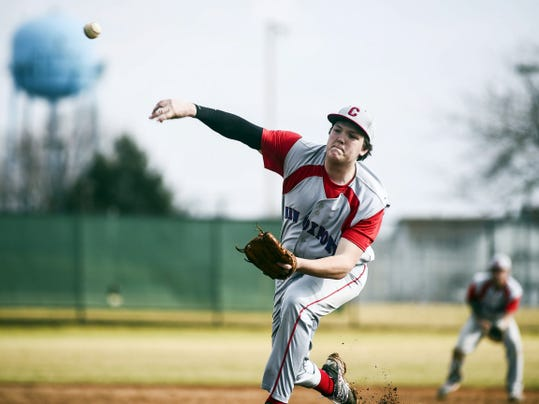 New Oxford's Alex Smith delivers a pitch during a game in March.