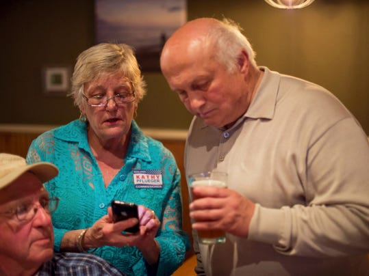 Democrat Kathy Pflueger looks for election results with Jake Long, who lost a bid for state representative in the 102nd District last fall, at Snitz Creek Brewery Tuesday night. Pflueger finished third in the voting, with Ralph Duquette coming in fourth. Chris Tarsa and incumbent Jo Ellen Litz were the top vote-getters.