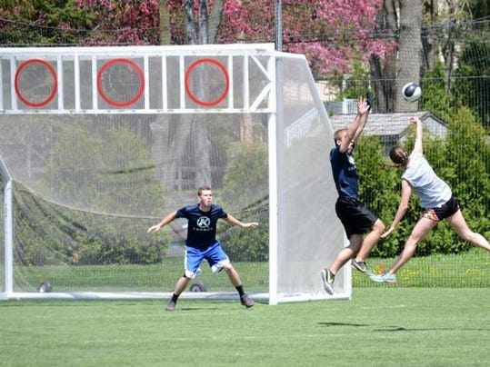 In the new sport of Kronum, players score when the ball crosses into the main goal or through any of the rings that are suspended above the goal. The sport was invented in the Philadelphia area and combines aspects of soccer, basketball and team handball. It's offered at Shippensburg University as a club team.
