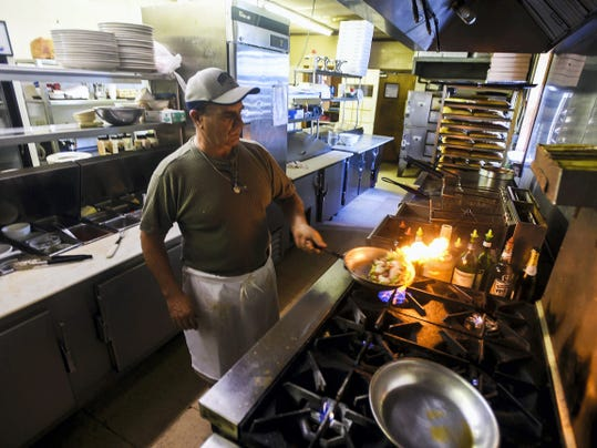 Tony Calderone, co-owner of the recently closed Buona Fortuna Ristorante, cooks up a sample pasta dish in this photo taken inside his former restaurant in July 2014.