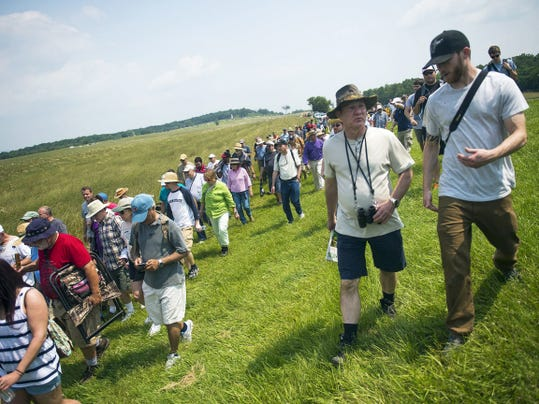 Gettysburg Military Park visitors participate in one of the 152nd Anniversary week's Battle Walks on Wednesday. The guided walks examine key phases of the battle and last two to three hours.