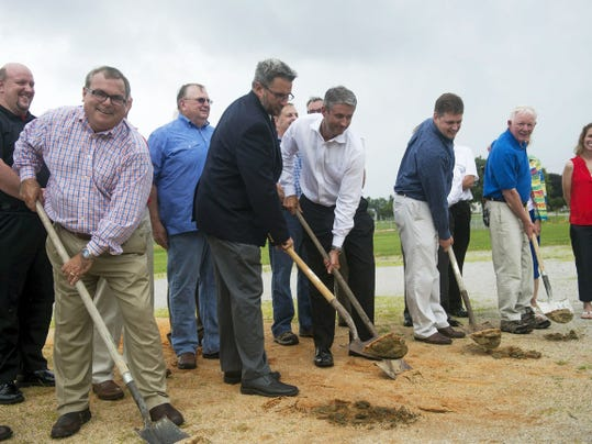From left, Hanover Public School District Superintendent John Scola, Hanover Mayor Ben Adams, Utz President and CEO Dylan Lissette, Conewago Contractors President Allen Smith and Jim Simpson break ground on a project at Moul Field on Monday.