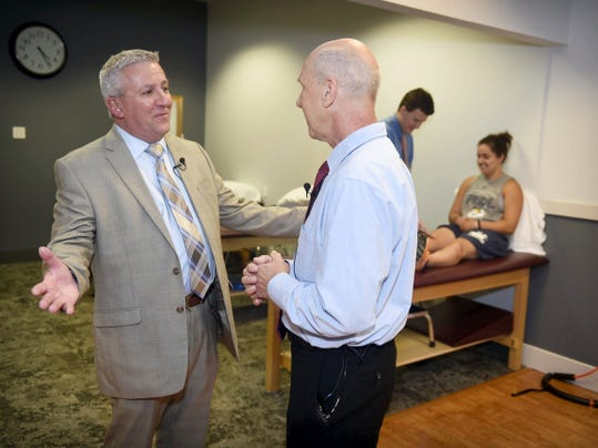 State Sen. Mike Folmer, left, and Stan Dacko, associate professor and department chair of physical therapy at Lebanon Valley College, share some thoughts during the Physical Therapy and Sports Rehabilitation Clinic's opening to the public Thursday. The facility started by treating Lebanon Valley College athletes but will start accepting other patients as well.
