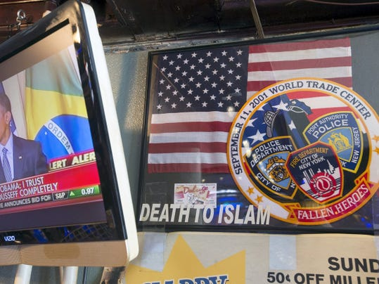 """This sign inside The Other Place bar has said """"Death to Islam"""" since the owner put it up in the aftermath of 9/11. Monday June 29, 2015"""